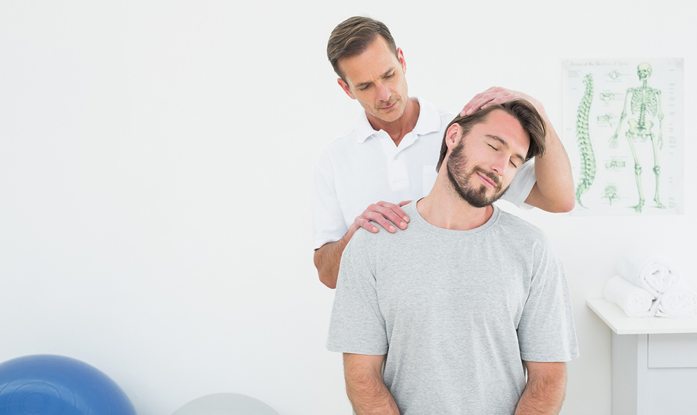 patient with chiropractor receiving an adjustment for neck pain