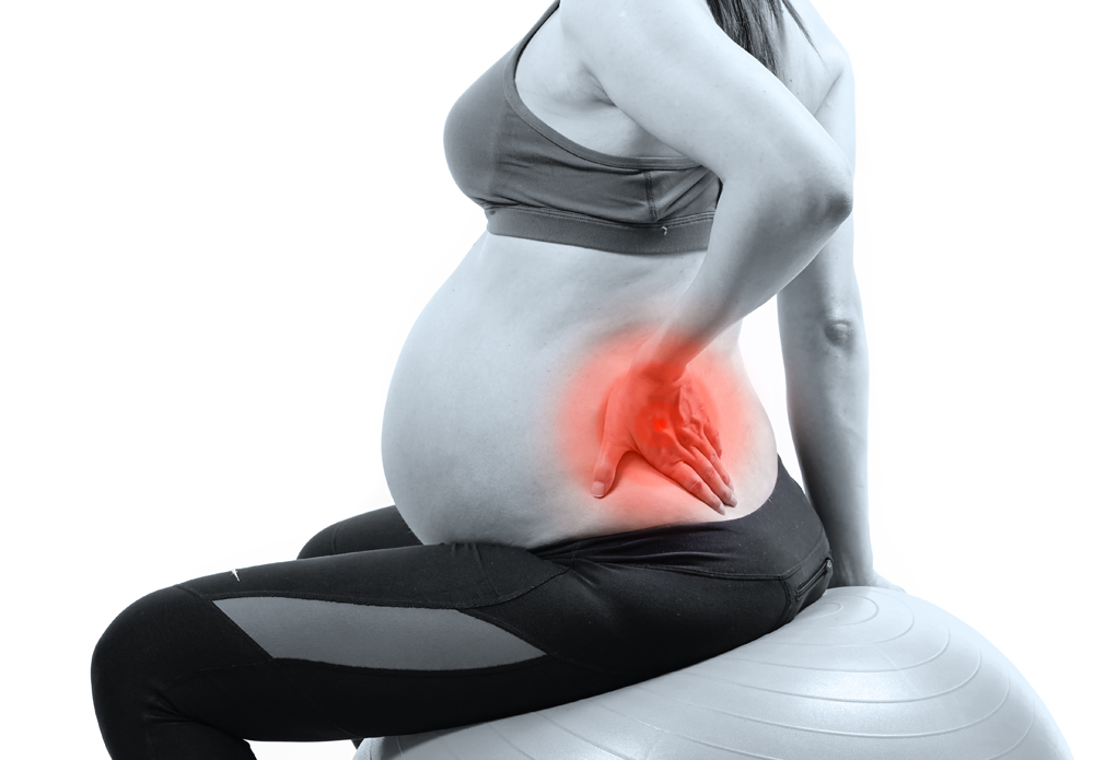 woman needing prenatal chiropractic
